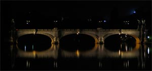 picture of an ancient bridge at night